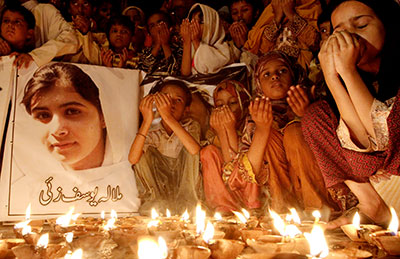 Pakistani children in Karachi pray for the recovery of 14-year-old schoolgirl Malala Yousafzai, who was shot by the Taliban, on October 12. (AP/Shakil Adil)