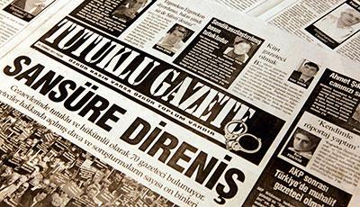Dozens of journalists for leftist Turkish newspaper Tutuklu Gazete have been jailed. The paper's headline reads, 'Resistance Against Censorship.' (Reuters)