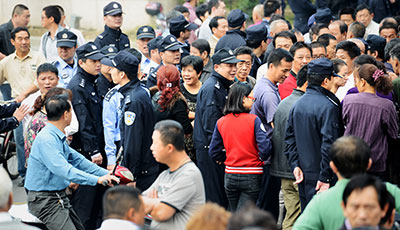 International journalists were obstructed from covering this protest in the city of Ningbo today. (AFP/Peter Parks)