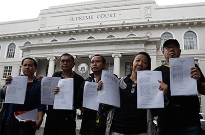 Filipino journalists show petitions against the Cybercrime Prevention Act that they submitted to the Supreme Court in Manila on Wednesday. (AP/Aaron Favila)