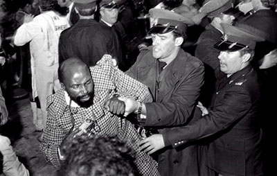 Alf Kumalo being arrested at a boxing match in Johannesburg in May 1976. (Alf Kumalo Foundation and Photographic Museum)