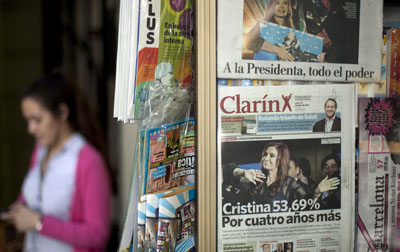 A newspaper stand displays Argentina's largest newspaper, Clarín. President Kirchner's government has given Clarín a December 7 deadline to sell off some of its holdings. (AP/Victor R. Caivano)
