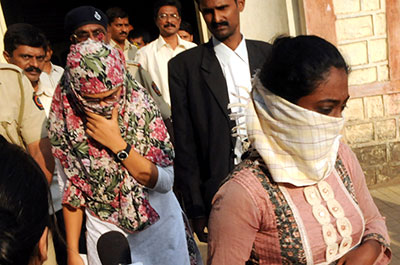 Shaheen Dhada, left, and Renu Srinivas, Indian women arrested for their Facebook posts, leave a Mumbai court Tuesday. (AP)