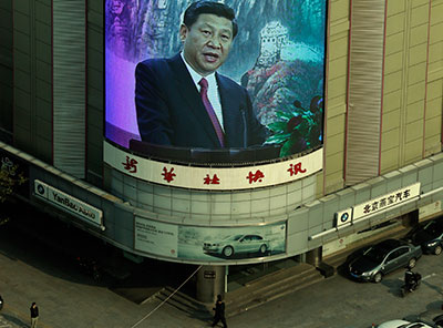 A mall's screen shows new Chinese Communist Party leader Xi Jinping in Beijing Thursday. (AP Photo/Lee Jin-man)