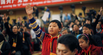 Eleven-year-old Zhang Jiahe asks a question during the 18th National Party Congress (NPC) in Beijing. (Reuters/Carlos Barria)