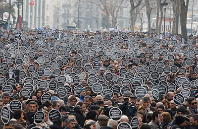 Protesters mark the fifth anniversary of the killing of Turkish-Armenian editor Hrant Dink in Istanbul January 19, 2012. (Reuters/Osman Orsal)