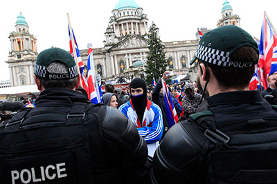 Protesters block the road in front of Belfast City Hall to protest a decision to limit display of the union flag. (Reuters/Cathal McNaughton)