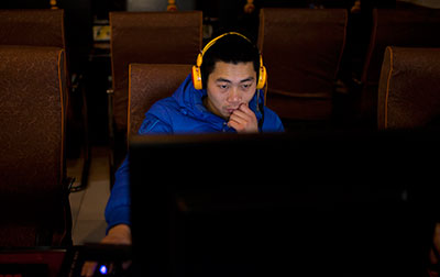 China's new Communist Party leaders are increasing already tight controls on Internet use. (AP/Alexander F. Yuan)