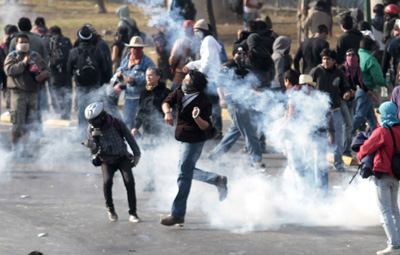Demonstrators clash with the police in Saturday's protest in Mexico City. (AFP/Pedro Pardo)