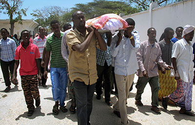 Friends and relatives carry the body of Abdisatar Daher Sabriye, a  journalist with state-run television who died in a September 20 suicide bomb attack. (AP/Mohamed Sheikh Nor)