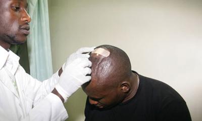 John Otanga seeks treatment for his head injury at a local hospital. (Nation/Billy Mutai)