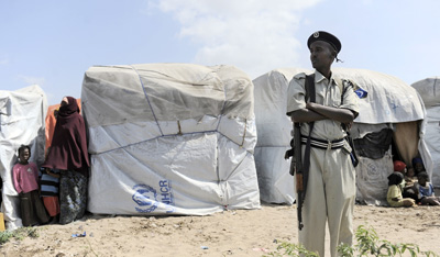 A police officer guards a camp of internally displaced persons in Mogadishu. (AFP/Tony Karumba)