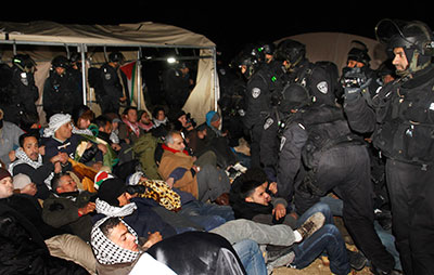 Israeli border police evict Palestinian activists at a campsite near Jerusalem on Friday. (AP/Nasser Shiyoukhi)