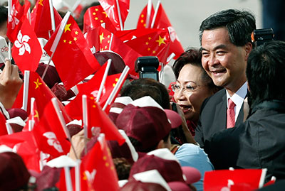 Hong Kong Chief Executive Leung Chun-ying and his wife attend a ceremony to mark the 15th anniversary of Hong Kong's handover to China on July 1, 2012. (AP/Kin Cheung)