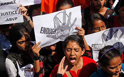 Last month's gang rape of a 23-year-old student provoked debate across India about the routine mistreatment of women and triggered daily protests demanding action. (AP/Aijaz Rahi)