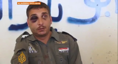 A Syrian pilot shot down and taken prisoner is interviewed by Al-Jazeera on October 17. (YouTube)