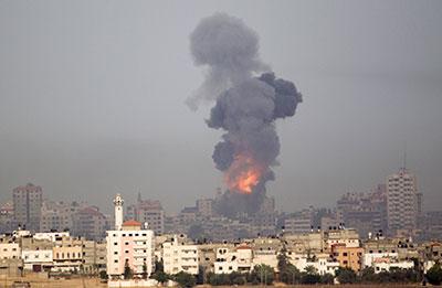 Smoke rises following an Israeli airstrike on Gaza on November 17, 2012. (AP/Ariel Schalit)