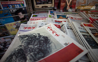 An editorial in the January 3 edition of Southern Weekly was changed from a call for constitutional rule into a tribute praising the Communist Party. (AP/Alexander F. Yuan)