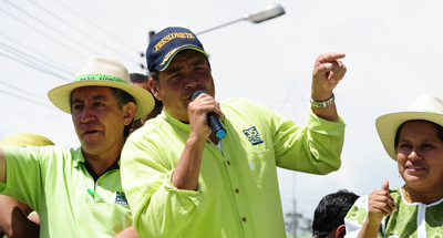 Critics say that Correa, seen here speaking during a campaign rally for the upcoming presidential election, has turned the Ecuadoran press into his whipping boy. (AFP/Rodrigo Buendia)