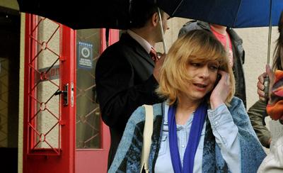 Irina Khalip speaks on her phone outside a Minsk courthouse in May 2011. (AFP/Viktor Drachev)