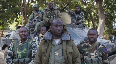 Soldiers with the Malian army speak to journalists. (Reuters/Joe Penney)