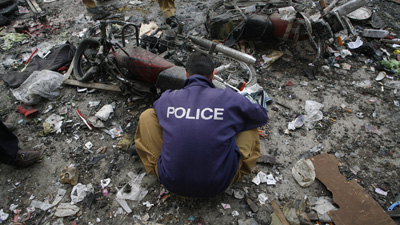 A bomb disposal officer checks the site of today's blast in Quetta, where at least two journalists were killed. (Reuters/Naseer Ahmed)