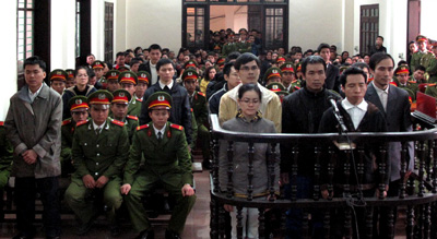 Vietnamese activists and bloggers stand for sentencing in court. (AFP/Vietnam News Agency)