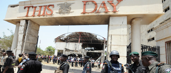 The Islamist militant sect Boko Haram claimed responsibility for this bombing of the offices of ThisDay newspaper in Abuja. (AFP/Pius Utomi Ekpei)