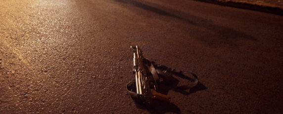 A Kalashnikov lies on the street after a shootout between police and drug traffickers in Zacatecas. (AFP/Guillermo Moreno)