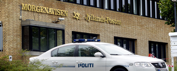 Police guard the offices of Danish newspaper Jyllands-Posten after the outlet was threatened for publishing a picture of Prophet Muhammad. (AFP/Brian Rasmussen)