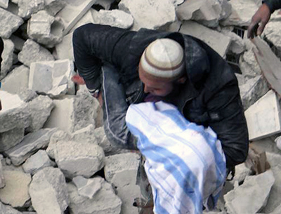 As Syria becomes riskier for both staff and freelance journalists, news organizations are more reliant on images from citizen journalists. An example is this image showing devastation in Aleppo, which was taken by the Aleppo Media Center and transmitted by The Associated Press on Sunday. (AP/Aleppo Media Center)