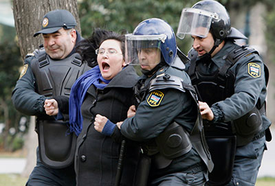 Police in Baku detain a woman who was protesting in solidarity with Ismayilli residents after a riot on January 26. (Reuters/David Mdzinarishvili)