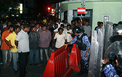 Supporters of former President Nasheed gather outside the Indian High Commission where Nasheed sought refuge to evade arrest. (AP/Ahmed Mujthaba)