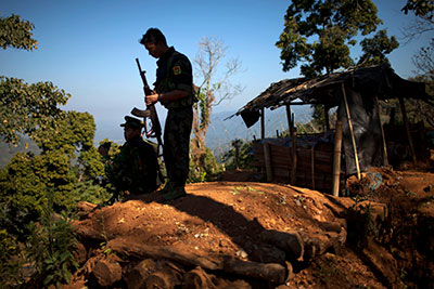 Kachin Independence Army soldiers guard an outpost in Northern Burma's Kachin-controlled region on January 31. Journalists who cover the conflict have been subject to email hacking attacks. (AP/Alexander F. Yuan)
