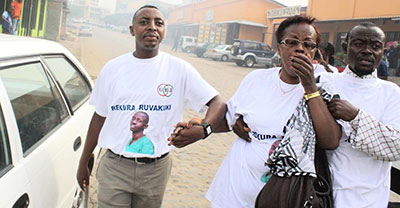 Burundi journalists react to tear gas at Tuesday's protest. (Teddy Mazina)