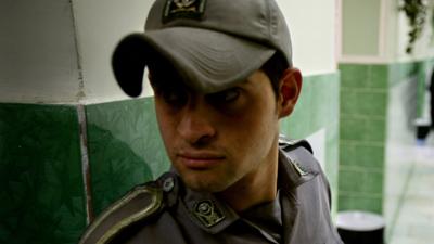 A guard patrols the hallways of Evin Prison. (Reuters/Morteza Nikoubazl)