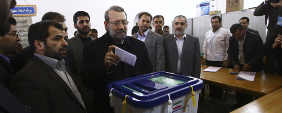 Potential presidential candidate Ali Larijani casts his vote in the parliamentary elections in March, 2012. (Reuters)