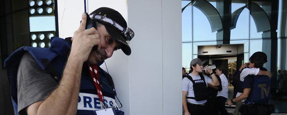A journalist in Libya speaks on his satellite phone. (AFP/Filippo Monteforte)