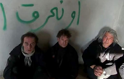 An image grab from a YouTube video uploaded on December 18 allegedly shows NBC employees, from left to right, Aziz Akyavas, Richard Engel, and John Kooistra in captivity in Syria. (AFP/YouTube)