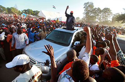 Kenyan Prime Minister and presidential candidate Raila Odinga waves to supporters at a campaign rally in Mombasa on Sunday. (Reuters/Joseph Okanga)
