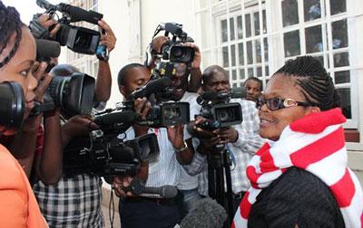 Reporters surround Beatrice Mtetwa as she exited a courthouse today. (ZLHR/Kumbirai Mafunda)