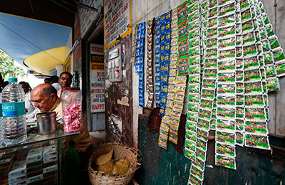 Dinesh Choudhary was attacked after reporting on illegal tobacco sales. Above, chewable tobacco is displayed at a roadside vendor near New Delhi. (AP/Saurabh Das)