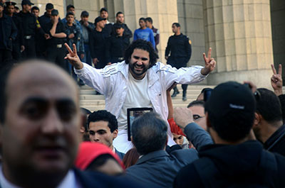 Egyptian blogger Alaa Abdel Fattah is surrounded by supporters as he leaves the prosecutor general's office in Cairo on Tuesday. (AP/Mostafa Darwish)