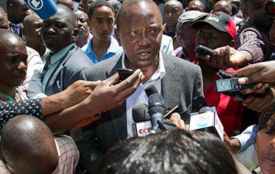 Presidential candidate Uhuru Kenyatta speaks to the press on election day. (AP)