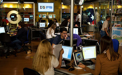 Globovisión's employees work at the station's main studio in Caracas. The broadcaster's owner has accepted a buyout offer. (Reuters/Carlos Garcia Rawlins)