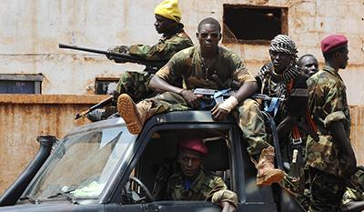 Seleka fighters cruise a neighborhood in Bangui. (AFP/Sia Kambou)