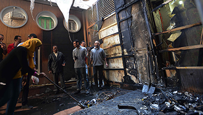 The Al-Watan offices were vandalized and set on fire on Saturday. (AFP/Al-Watan)
