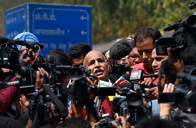 V.K. Anand, lawyer for Ram Singh, a man on trial for the gang rape and killing of a 23-year-old student aboard a New Delhi bus, addresses the media outside a hospital in New Delhi on March 11 after Singh was found dead in prison. (AP/Saurabh Das)