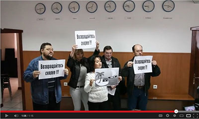 In this YouTube screenshot, supporters of independent media demonstrate at the press conference where owners of Stan.kz announced its shutdown. (YouTube/Respublika Kz)