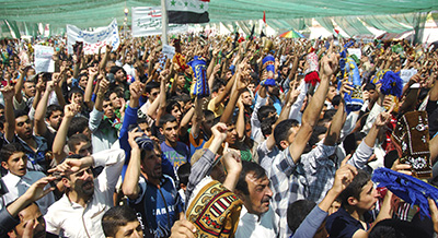 Sunni Muslims chant during an anti-government protest in Samarra. (Reuters/Bakr al-Azzawi)